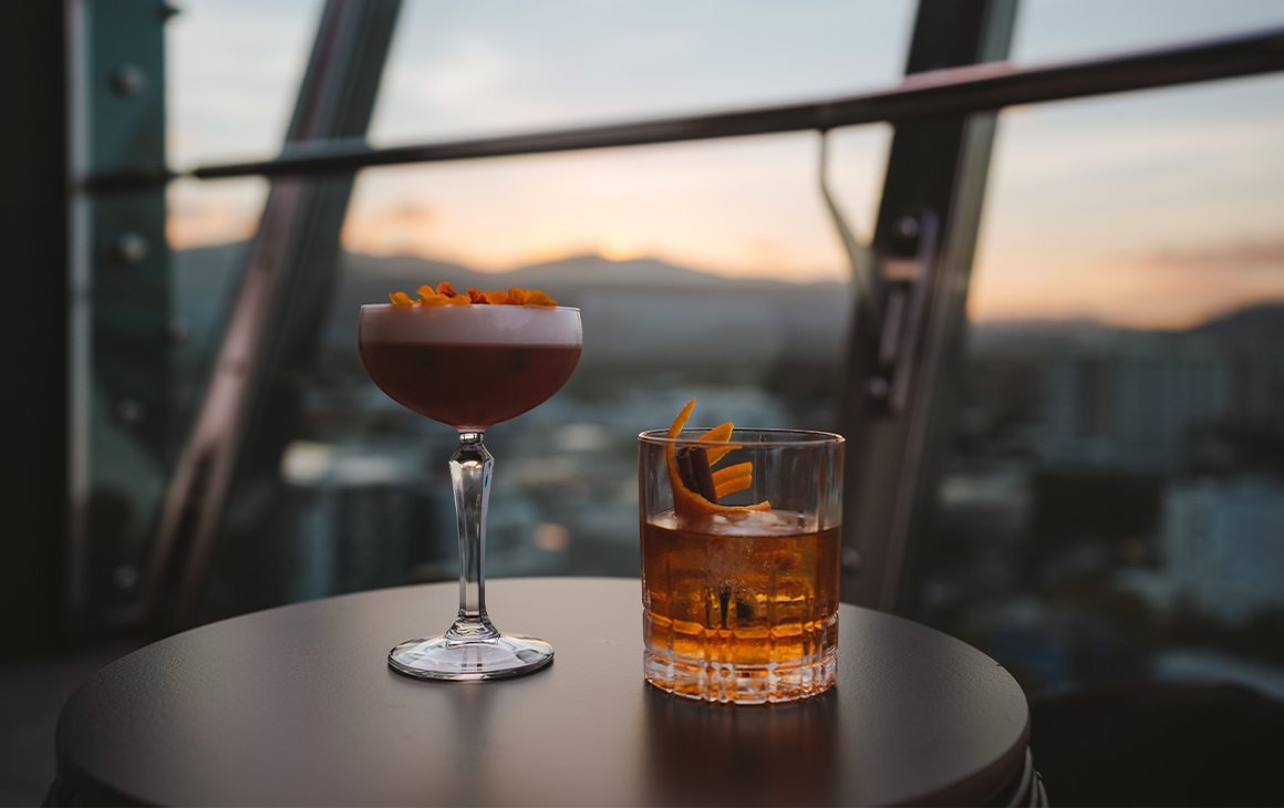 two drinks on table of rooftop bar