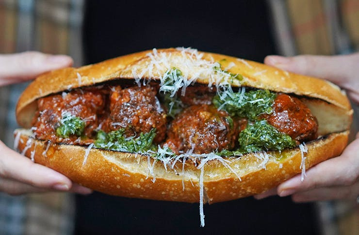 A meatball sub covered in red sauce and cheese from Rocco's Bologna Discoteca.