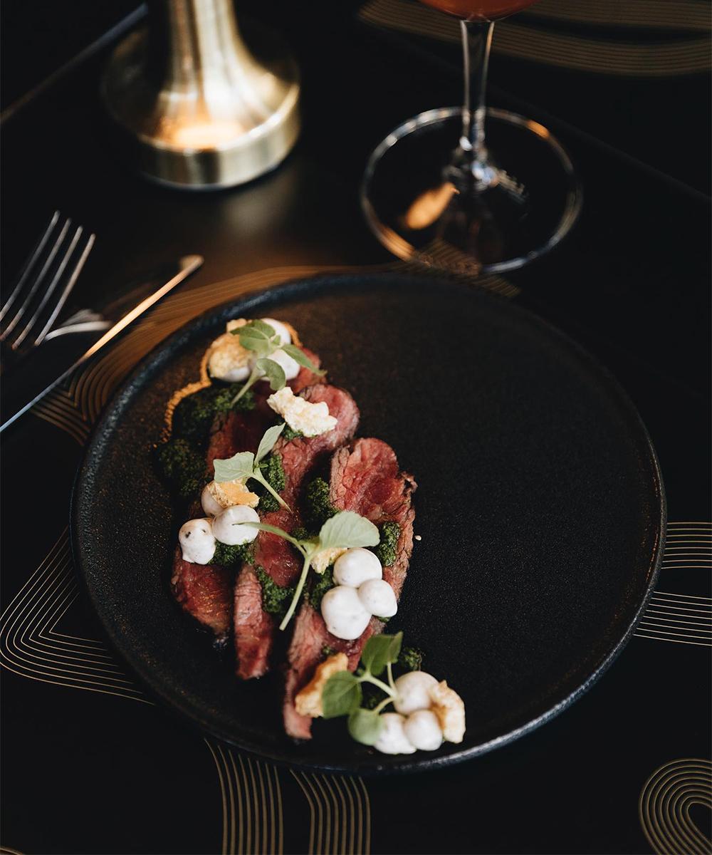 a plate of sliced steak