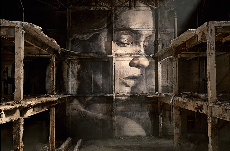 A detailed portrait of a woman's face behind several shelves in a dimly lit building.