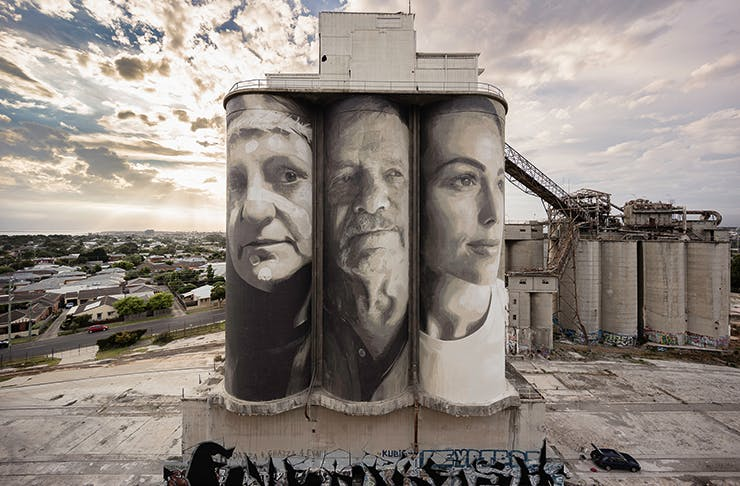 Large scale portrait paintings by RONE on wheat silos.