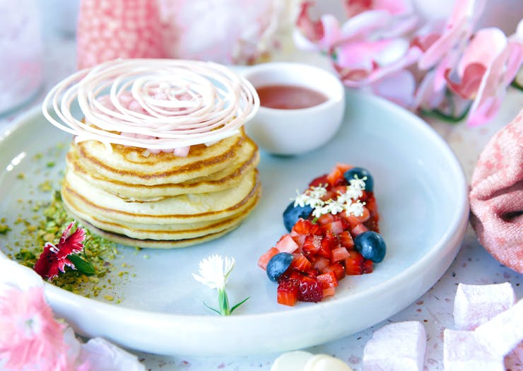 bowl of pancakes topped with a whirl of white chocolate