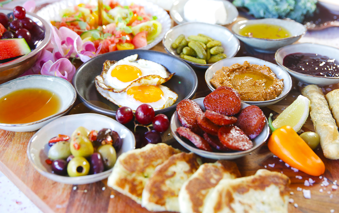 a board with small bowls of middle eastern foods covering it