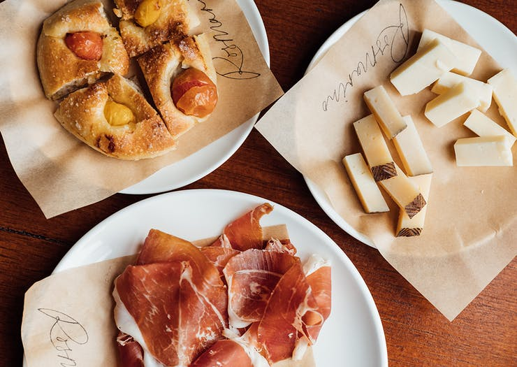 plates of charcuterie, cheese and focaccia