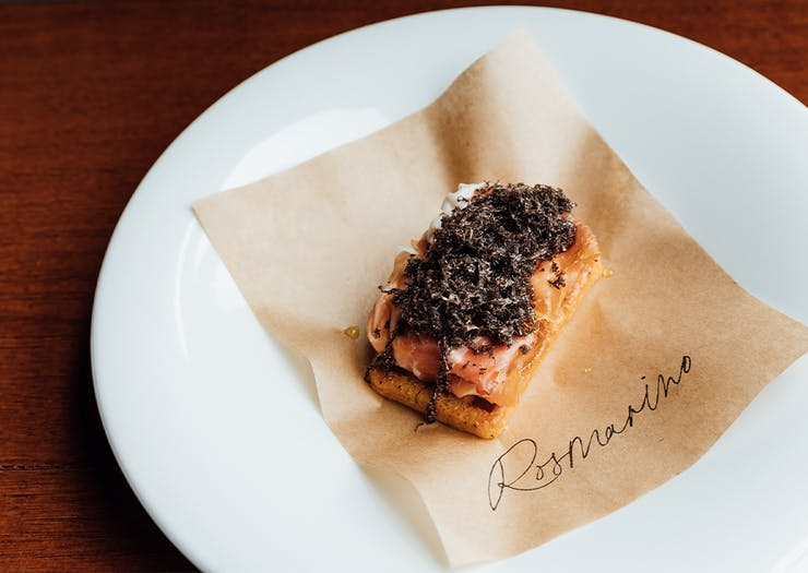a bar bite dish topped with truffle