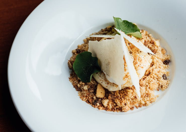 a dessert with crumble and chocolate shards
