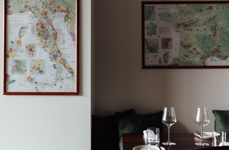 a table below framed maps