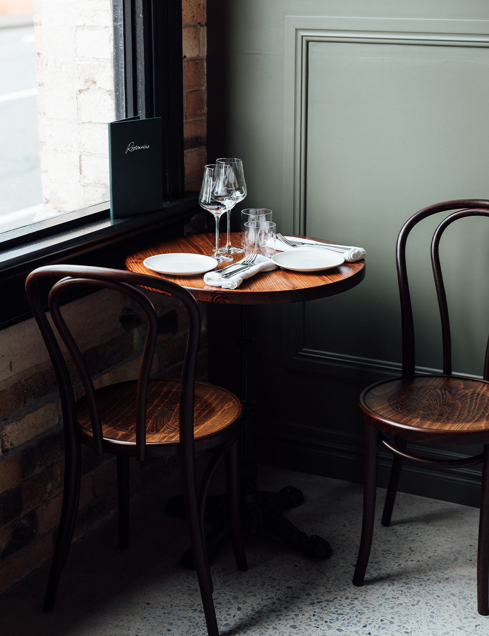 a table in a corner by a windwo