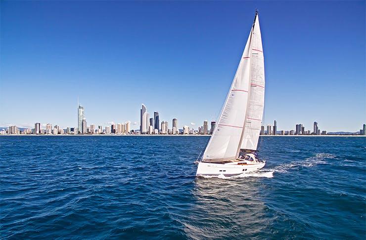 a yacht against the surfers paradise skyline