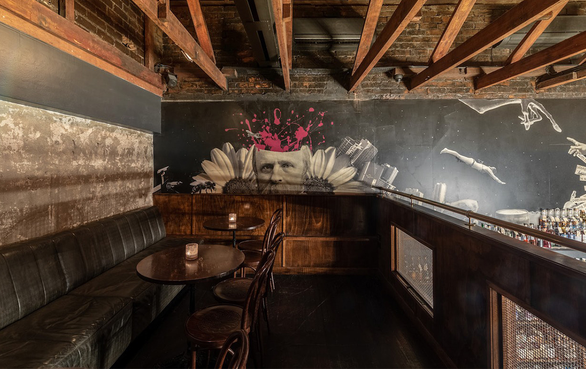 a loft seating area inside a bar