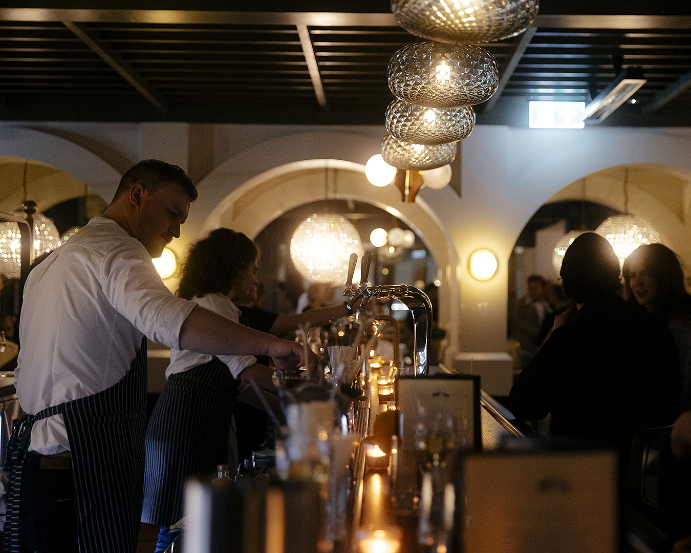 The busy bar at Saxon + Parole.