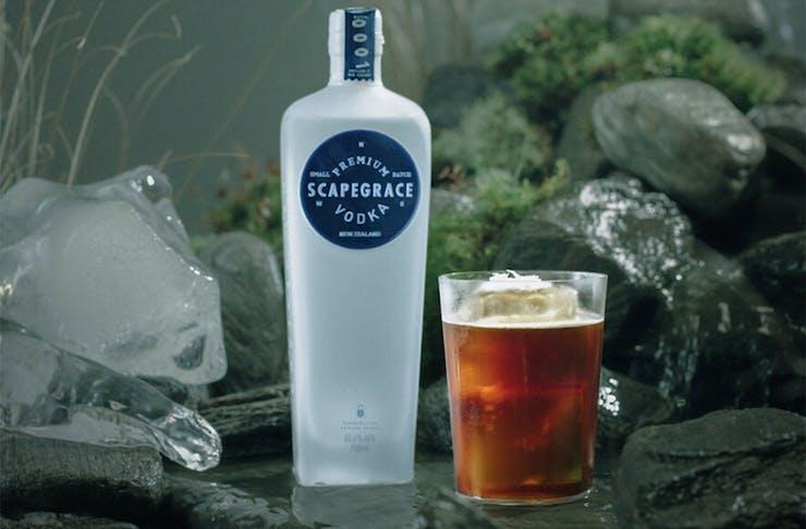 Scapegrace's Crema cocktail next to a bottle of Scapegrace vodka.