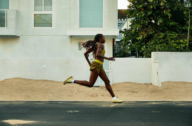 a woman running down a street