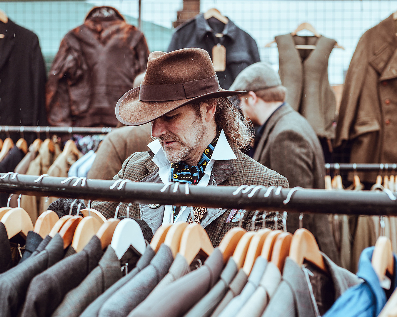 A man shops for new second hand threads.