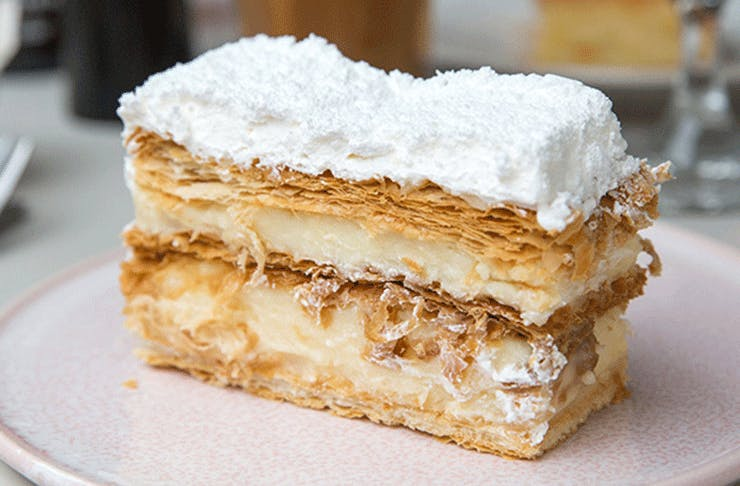 A delicious mille-feuille with flakey pastry, filled with custard and topped with white icing.