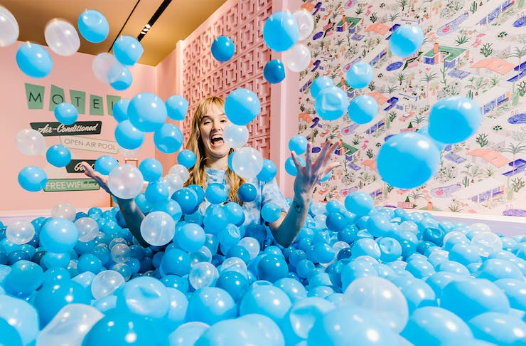 a woman in a blue ballpit