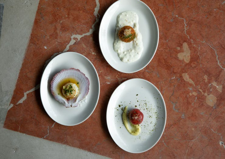 Three plates laid out on a marble surface.