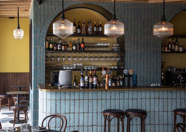 The blue-tiled bar at Sella Vinoteca in Sydney.