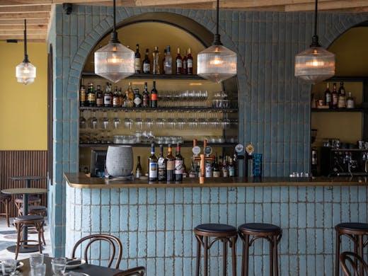 The blue tiled bar at Sella Vinoteca in Sydney.