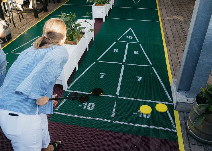 Challenge Your Mates To A Game Of Giant Shuffleboard At This Leafy Rooftop Bar