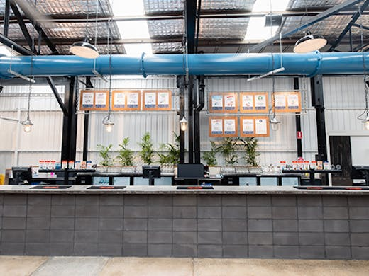 a bar in a warehouse style space