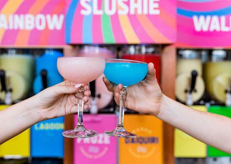 Prepare For A Brain Freeze, This Riverside Bar Is Pouring Alcoholic Rainbow Slushies