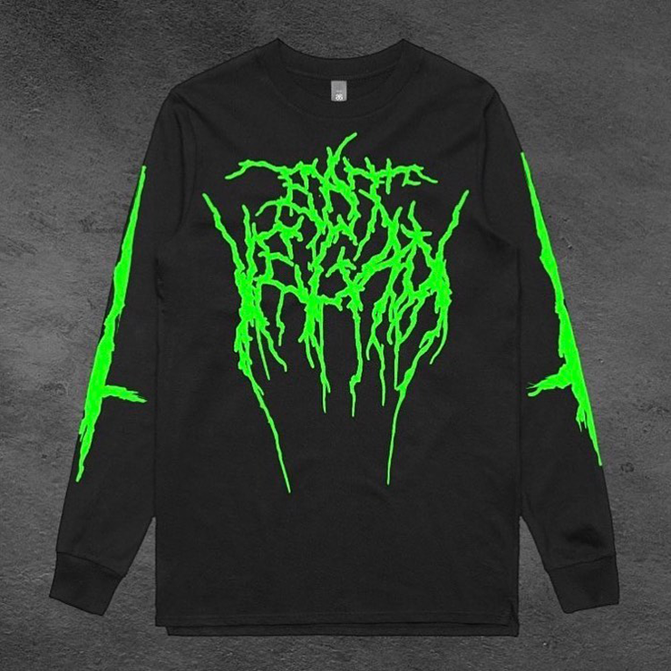 A block long-sleeve tshirt with green 'heavy metal' print on it.