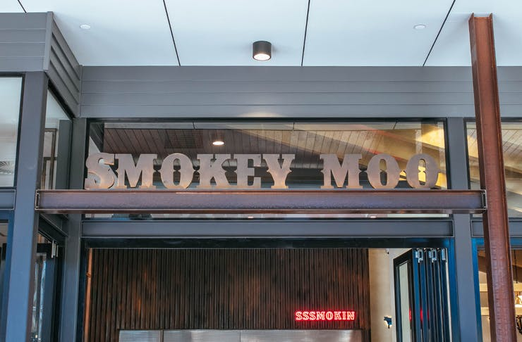 Restaurant sign out front of Smokey Moo.