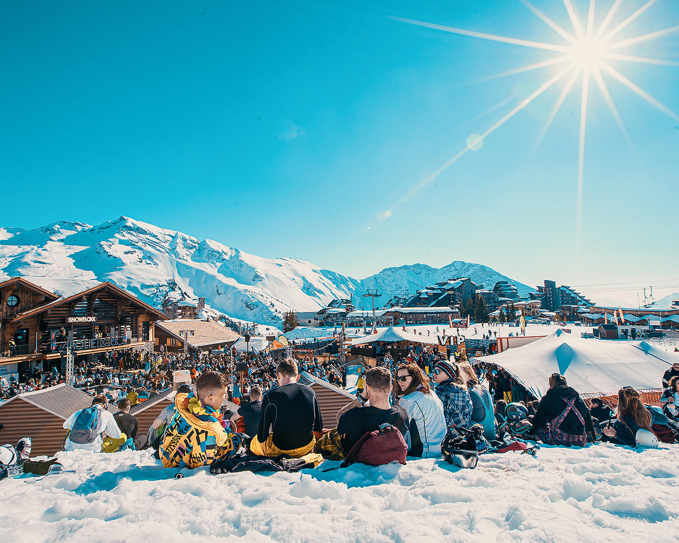 Partygoers take five on the beautiful slopes at Treble Cone.