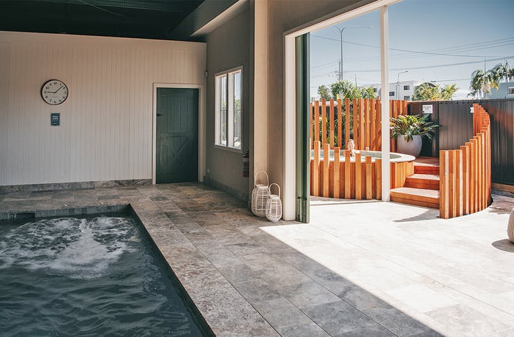 a pool and an outdoor spa at soak bathhouse