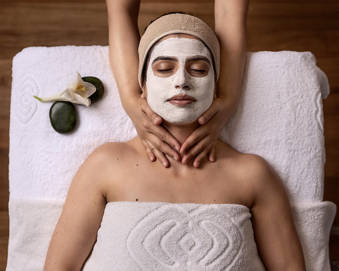 A woman relaxes as she receives her treatment at Sofitel Spa.
