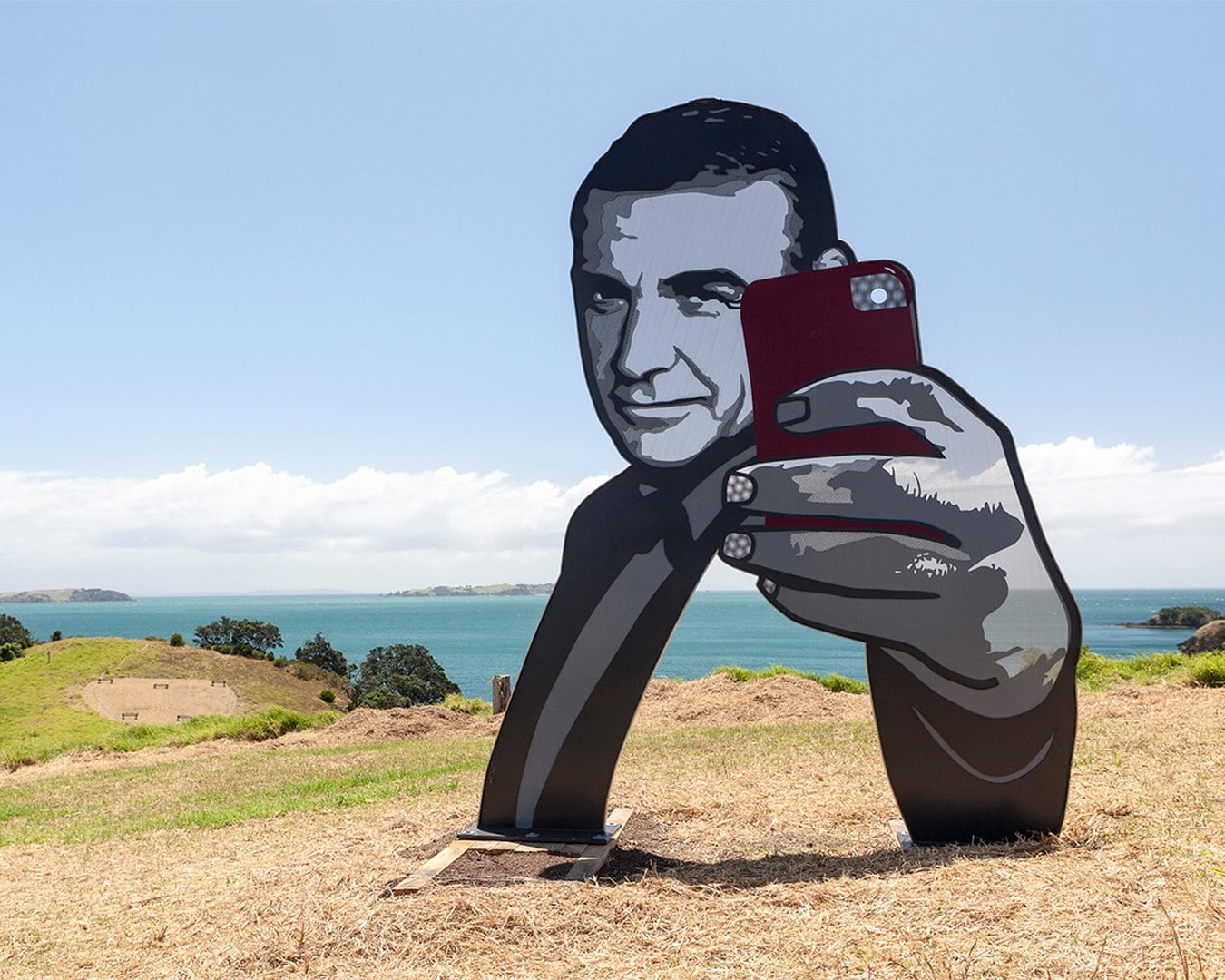 Sculpture on the gulf shows Roger Moore taking a selfie.
