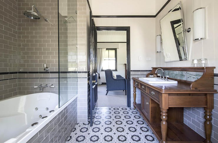 Interior of one of Spicers Hidden Vale's cabin bathrooms, with a spa bath on one side.