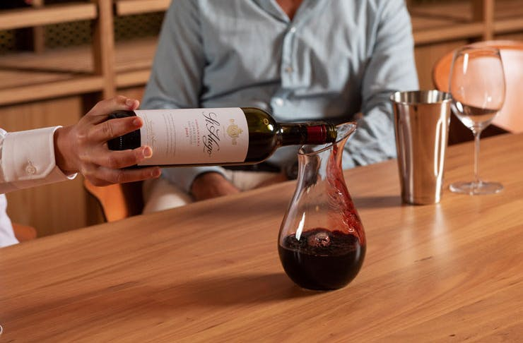 A bottle of St Hugo wine being poured.
