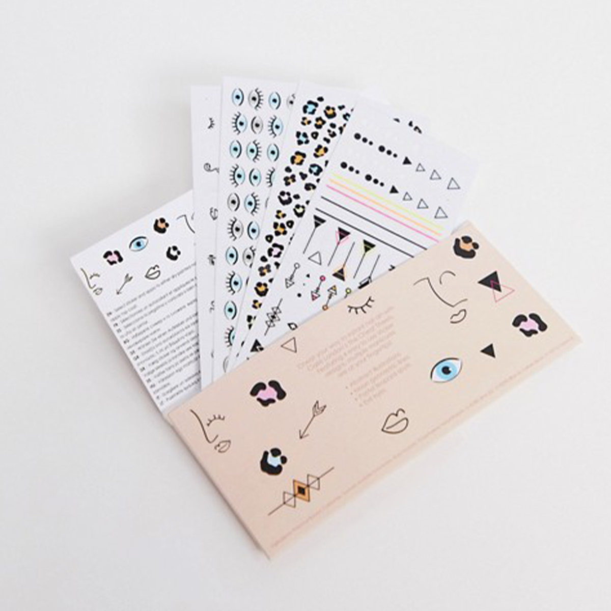 Several sheets of nail art stickers splayed out