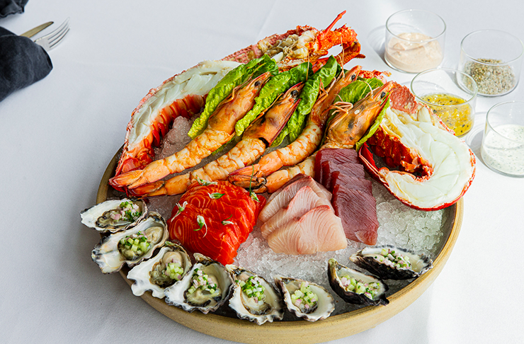 A seafood picnic with crayfish and oysters.