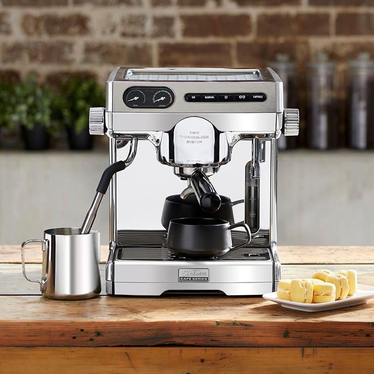 A silver Sunbeam home coffee machine.