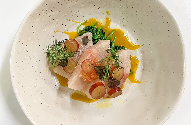 A top down shot of a raw-fish dish from Gathar's supper club.