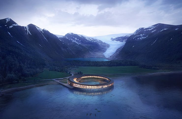 A ring-shaped hotel positioned above a lake in Norway.