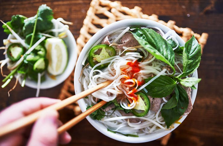 A top-down view of a bowl of pho.