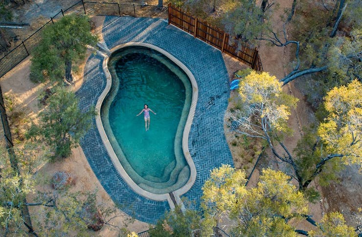 a woman in a pool seen from the air