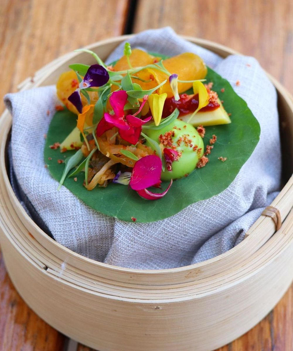 a bamboo steamer filled with pretty veggies