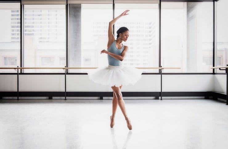 Ballerina in light-filled studio