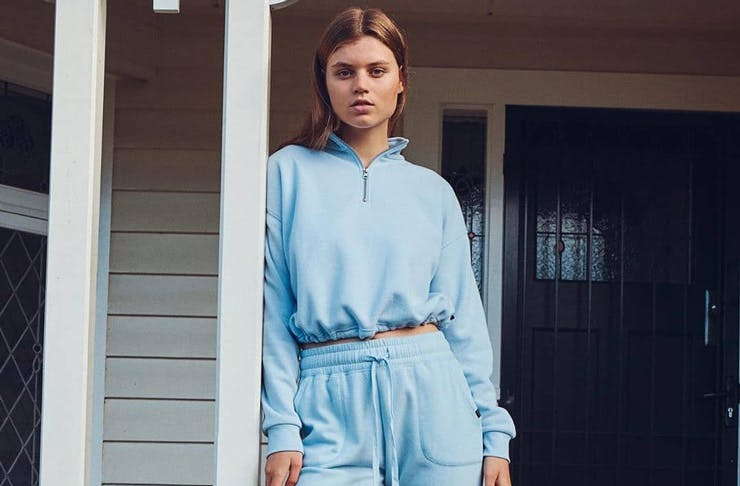 A model wearing a blue matching tracksuit set, available to shop at The Iconic.