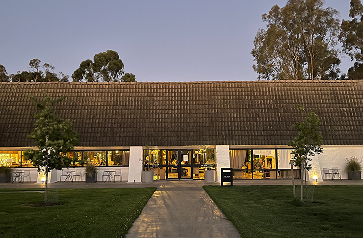 A winery and restaurant at dusk.