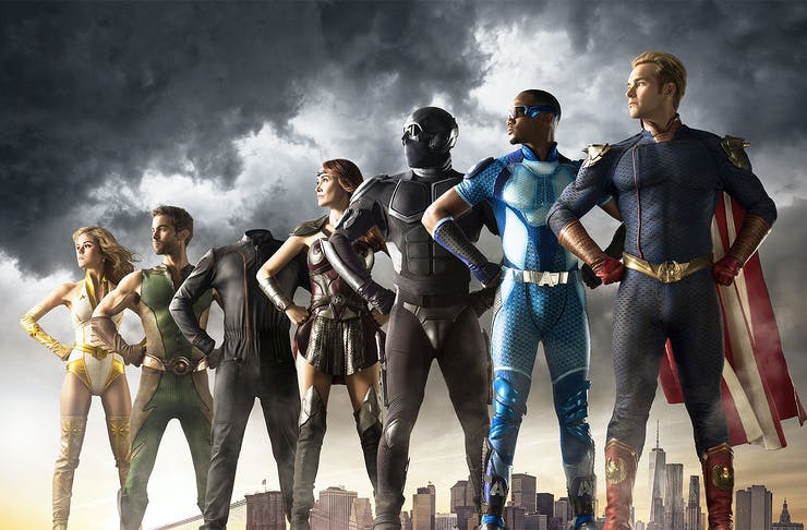 The alleged superheroes stand in a line.