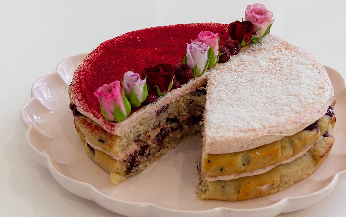 A two-layer berries and cream cake from The Caker, one of the best cake shops in Auckland.