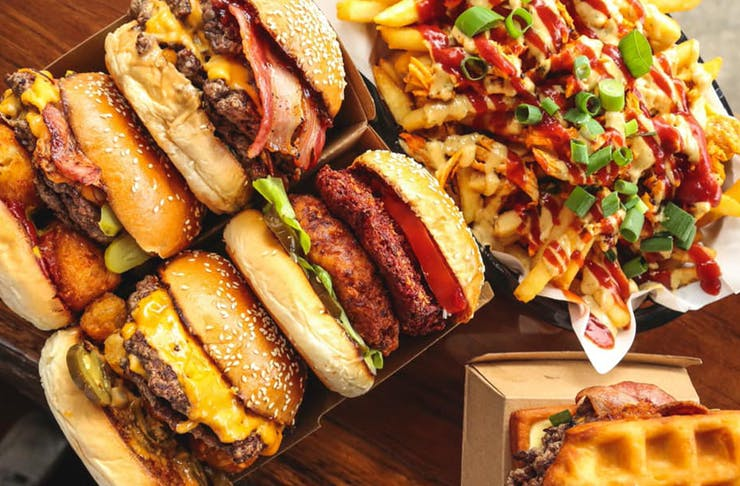 a heap of burgers and loaded fries