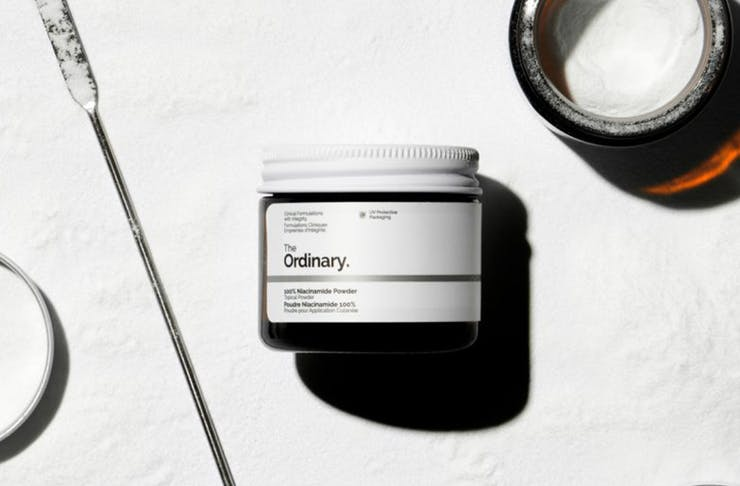 a jar of the niacinamide powder