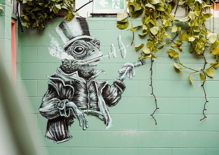 another mural of a frog wearing a top hat